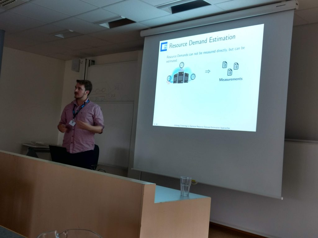 """Johannes Grohman from the University of Würzburg talking about """"Utilizing Clustering to Optimize Resource Demand Estimation Approaches""""."""